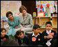 Mrs. Laura Bush listens to a student answer a question as she attends a class lesson in the Children's Resources International clasroom at the U.S. Embassy , Saturday, March 4, 2006 in Islamabad, Pakistan. White House photo by Shealah Craighead
