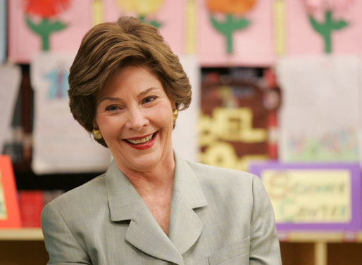 Mrs. Laura Bush reacts to a question as she attends a class lesson in the Children's Resources International clasroom at the U.S. Embassy , Saturday, March 4, 2006 in Islamabad, Pakistan. White House photo by Shealah Craighead