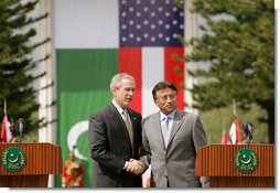 President George W. Bush and Pakistan President Pervez Musharraf stand together following their joint news conference at Aiwan-e-Sadr in Islamabad, Pakistan, Saturday, March 4, 2006.  White House photo by Shealah Craighead