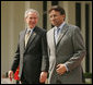 President George W. Bush and Pakistan President Pervez Musharraf walk together to their joint news conference at Aiwan-e-Sadr in Islamabad, Pakistan, Saturday, March 4, 2006. White House photo by Shealah Craighead