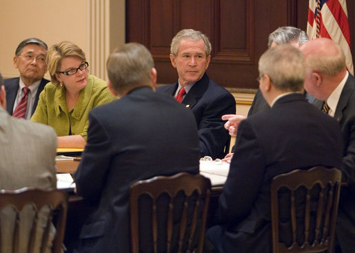 President George W. Bush sits with Secretary of Education Margaret Spellings and Secretary of Transportation Norman Mineta during a drop-by meeting Monday, March 6, 2006, with the Academic Competitiveness Council in the Eisenhower Executive Office Building. White House photo by Kimberlee Hewitt