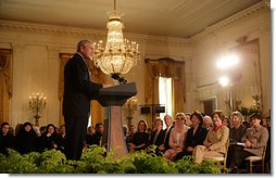 "President George W. Bush joins in the celebration of International Women's Day at the White House Tuesday, March 7, 2006, as he thanks the female members of his audience for their leadership. ""The struggle for women's right is a story of strong women willing to take the lead,"" the President told them and added, America's ""a better place because of the leadership of women throughout our history.""  White House photo by Shealah Craighead"