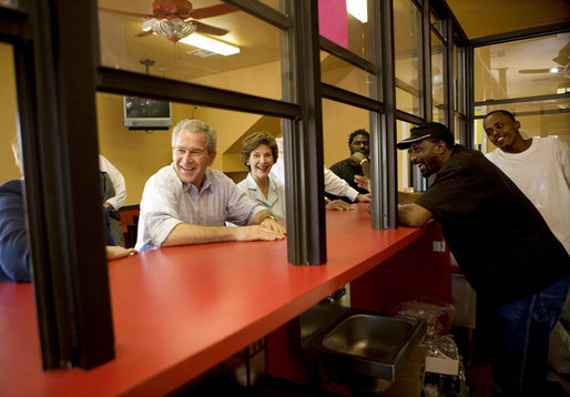 President George W. Bush and Laura Bush stop in at Stewart's Diner in the Ninth Ward of New Orleans, Wednesday, March 8, 2006, during their visit to view the city's reconstruction progress six-months after being devastated by Hurricane Katrina. White House photo by Eric Draper