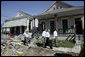 President George W. Bush views the destruction to homes and debris piles while touring the lower 9th Ward of New Orleans, Wednesday, March 8, 2006 with New Orleans Mayor Ray Nagin, right. White House photo by Eric Draper