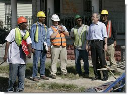 President George W. Bush talks with workers cleaning up the hurricane ravaged neighborhood of the lower 9th Ward of New Orleans, Wednesday, March 8, 2006, during a tour of New Orleans neighborhoods. White House photo by Eric Draper