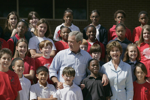 President George W. Bush and Laura Bush pose with students at the College Park Elementary School in Gautier, Miss., Wednesday, March 8, 2006, where Mrs. Bush announced the establishment of The Gulf Coast School Library Recovery Initiative, to help Gulf Coast schools that were damaged by the hurricanes rebuild their book and material collections. The initiative was established by the Laura Bush Foundation for American Libraries. White House photo by Eric Draper