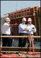 President George W. Bush and New Orleans Mayor Ray Nagin, right, view flood wall construction in the Industrial Levee Canal, Wednesday, March 8, 2006 in New Orleans, during a tour to view the clean up and reconstruction progress of New Orleans six-months after the city was devastated by Hurricane Katrina. White House photo by Eric Draper