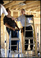 President George W. Bush shakes hands with people helping rebuild Jerry Akins family home, Wednesday, March 8, 2006 in Gautier, Miss., on the site where the Akins home was destroyed by Hurricane Katrina. White House photo by Eric Draper