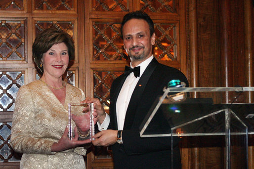 "Mrs. Laura Bush is presented with an award by Kuwait Ambassador Al-Sabah, Tuesday evening, March 8, 2006 at the at ""Bridges of Hope: Educating Children for a Better Future,"" The Kuwait-America Foundation's 2006 Benefit Dinner in Washington, in honor of her dedication to help improve the living conditions and education of children around the world. White House photo by Shealah Craighead"