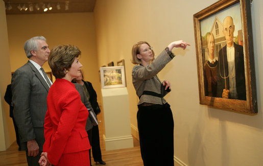 "Mrs. Laura Bush listens Thursday evening, March 9, 2006 to Jane Milosch, curator of the Smithsonian American Art Museum's Renwick Gallery in Washington, as Mrs. Bush is shown the famous Grant Wood painting ""American Gothic,"" during a tour of the Renwick Gallery exhibit, ""Grant Wood's Studio: Birthplace of American Gothic,"" scheduled to open Friday, March 10, 2006. Mrs. Bush is accompanied on the tour by Ned. L. Rifkin, under secretary of art at the Smithsonian Institution. White House photo by Shealah Craighead"