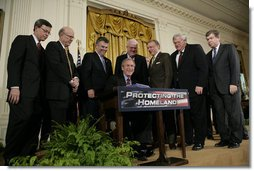 President George W. Bush is joined by House and Senate representatives as he signs H.R. 3199, USA Patriot Improvement and Reauthorization Act of 2005, Thursday, March 9, 2006 in the East Room of the White House. From left to right are U.S. Sen. Jim Talent, R-Mo.; U.S. Sen. Pat Roberts, R-Kan.; U.S. Rep. Peter King, R-NY; U.S. Rep. Jim Sensenbrenner, R-Wis.; U.S. Sen. Arlen Specter, R-Pa.; House Speaker Dennis Hastert, R-Ill., and Majority Whip U.S. Rep. Roy Blunt, R- Mo. White House photo by Eric Draper