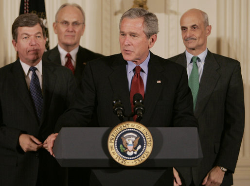 President George W. Bush addresses the audience after signing H.R. 3199, USA Patriot Improvement and Reauthorization Act of 2005, Thursday, March 9, 2006 in the East Room of the White House. President Bush is joined by U.S. Congressman Roy Blunt, R-Mo., left, U.S. Senator Larry Craig, R-Id., background-left, and Homeland Security Secretary Michael Chertoff. White House photo by Kimberlee Hewitt
