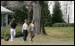 Mrs. Laura Bush takes a brisk walk with Barbara Harrison of WRC-TV (NBC 4) around the South Grounds of the White House Friday, March 10, 2006, during an interview given by Mrs. Harrison. The focus of the interview is to promote exercise and health awareness. White House photo by Shealah Craighead