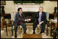 President George W. Bush welcomes Peru's President Alejandro Toledo to the Oval Office, Friday, March 10, 2006 at the White House. White House photo by Eric Draper
