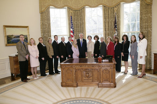 President George W. Bush and Mrs. Laura Bush meet Friday, March 10, 2006 in the Oval Office of the White House, with representatives from various organizations honored for their support the U.S. military. White House photo by Eric Draper