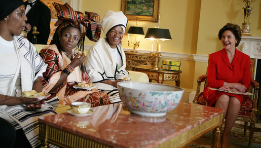 "Mrs. Laura Bush visits with representatives from the Mothers to Mothers-To-Be program of South Africa, Monday, March 13, 2006 in the Yellow Oval Room in the private residence at the White House. Mrs. Bush had earlier met with members of the program, who mentor and counsel mothers who come for prenatal care to clinics and find they are HIV-positive, on her visit to South Africa in July of 2005. From left to right are Babalwa Mbono, Aunt Manyongo ""Kunene"" Mosima Tantoh and Gloria Ncanywa. White House photo by Kimberlee Hewitt"