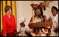 "Mrs. Laura Bush reacts to remarks from Aunt Manyongo ""Kunene"" Mosima Tantoh, a member of the Mothers to Mothers-To-Be organization of South Africa, Monday, March 13, 2006 in the East Room at the White House. Mrs. Bush had earlier met with members of the group, who mentor and counsel mothers who come for prenatal care to clinics and find they are HIV-positive, on her visit to South Africa in July of 2005. Group member Gloria Ncanywa is seen at right. White House photo by Shealah Craighead"
