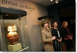 Mrs. Laura Bush, accompanied by Mrs. Marta Sahagun de Fox and Mrs. Eliane Karp de Toledo, talks with reporters following her tour of the Divine and Human: Women in Mexico and Peru Exhibit, Tuesday, March 14, 2006 at The National Museum of Women in the Arts in Washington.  White House photo by Shealah Craighead