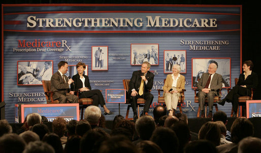 President George W. Bush participates in a Conversation on the Medicare Prescription Drug Benefit, Tuesday, March 14, 2006 at the Canandaigua Academy in Canandaigua, N.Y., with Dr. Mark McClellan and Diane Lawatsch, left, and Bob and Eleanor Wisnieff with Susan Wiber, right. White House photo by Kimberlee Hewitt