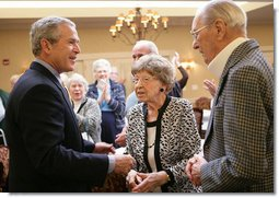 President George W. Bush is applauded as he arrives Tuesday, March 14, 2006 to the Ferris Hills at West Lake Senior Center in Canandaigua, N.Y., to discuss the benefits of the new Medicare prescription drug program. White House photo by Kimberlee Hewitt