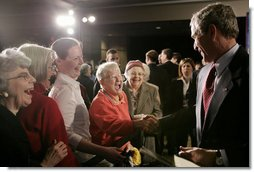 President George W. Bush meets with audience members following his remarks on the new Medicare Prescription Drug Benefit Program at the Riderwood Villiage retirement community, Wednesday, March 15, 2006 in Silver Spring, Md. President Bush urged seniors to get information about the new Medicare benefit program and sign up by the May 15th deadline.  White House photo by Paul Morse