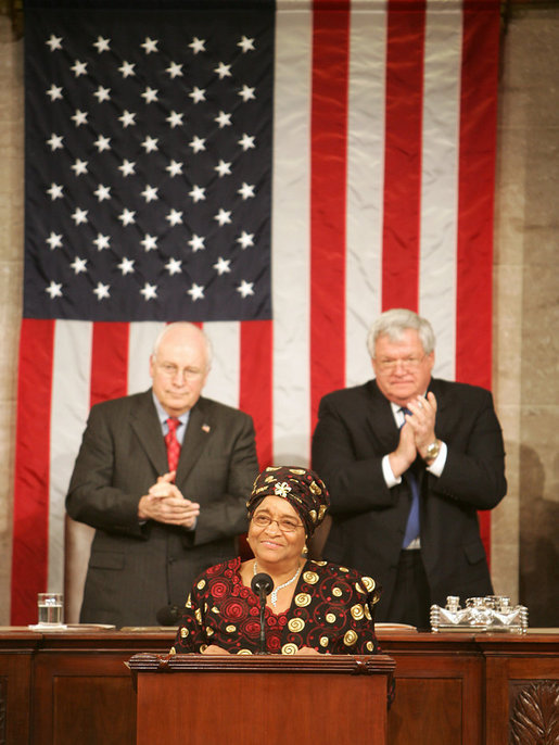 Vice President Dick Cheney and House Speaker J. Dennis Hastert applaud Liberian President Ellen Johnson-Sirleaf during an address to a Joint Meeting of Congress, Wednesday, March 15, 2006. The President's speech marked the beginning of a multi-day trip to Washington that will include meetings with US officials in an effort to garner support as she leads her country in economic reconstruction and reform. White House photo by David Bohrer