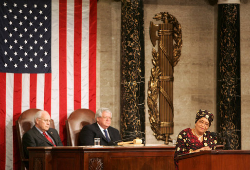 Vice President Dick Cheney and House Speaker J. Dennis Hastert listen as President Ellen Johnson-Sirleaf, Liberia and Africa's first female head-of state, addresses a Joint Meeting of Congress held in her honor at the Capitol, Wednesday, March 15, 2006. White House photo by David Bohrer