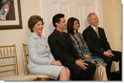 Mrs. Laura Bush attends the Afghan Children's Initiative Benefit Dinner at the Afghanistan Embassy in Washington, DC on Thursday evening, March 16, 2006. Seated with Mrs. Bush are Dr. Khaled Hosseini, author of The Kite Runner; Mrs. Shamim Jawad, host and wife of the Afghan Ambassador to the U.S.; and Mr. Tim McBride, member of the U.S.-Afghan Women's Council.  White House photo by Shealah Craighead