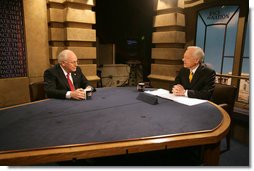 Vice President Dick Cheney talks with Bob Schieffer during an interview on CBS's Face the Nation at CBS studios in Washington, Sunday, March 19, 2006.  White House photo by David Bohrer