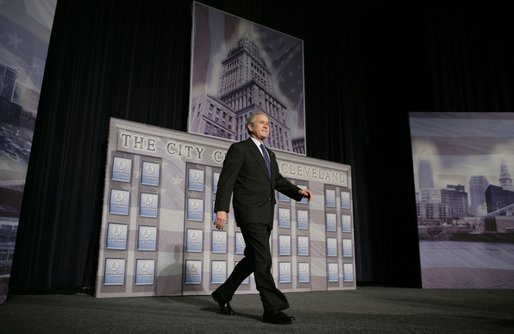 President George W. Bush walks on stage at the Renaissance Cleveland Hotel in Cleveland, Ohio, to deliver his remarks on the global war on terror, Monday, March 20, 2006, to members of the City Club of Cleveland. White House photo by Paul Morse