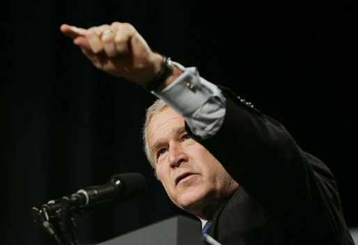 President George W. Bush calls on an audience member to ask a question at the Renaissance Cleveland Hotel in Cleveland, Ohio, following his remarks on the global war on terror, Monday, March 20, 2006, to members of the City Club of Cleveland. White House photo by Paul Morse