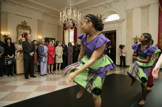 President George W. Bush and Mrs. Laura Bush join Liberia's President Ellen Johnson Sirleaf in viewing a dance performance by Moving in the Spirit, on the State Floor of the White House, Tuesday, March 21, 2006, prior to a social luncheon in honor of President Sirleaf. White House photo by Eric Draper