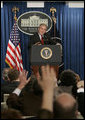 President George W. Bush answers reporters questions, Tuesday morning, March 21, 2006, during a news briefing at the White House. White House photo by Paul Morse