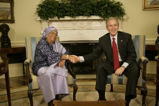 President George W. Bush welcomes Liberia's President Ellen Johnson Sirleaf to the Oval Office at the White House, Tuesday, March 21, 2006. President Sirleaf is the first woman elected President to any country on the continent of Africa. White House photo by Eric Draper