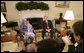 President George W. Bush and Liberia's President Ellen Johnson Sirleaf speak to reporters in the Oval Office at the White House, Tuesday, March 21, 2006. President Sirleaf, the first woman elected President to any country on the continent of Africa, thanked President Bush, the American people and the U.S. Congress for helping support Liberia's transition from war to peace. White House photo by Eric Draper