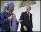 President George W. Bush and Liberia's President Ellen Johnson Sirleaf talk as they walk along the Colonnade from the Oval Office at the White House, Tuesday, March 21, 2006. White House photo by Eric Draper