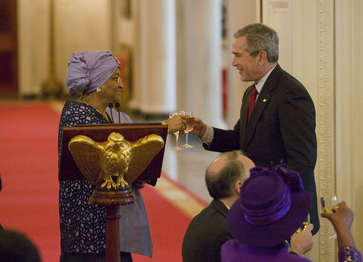 President George W. Bush toast Liberia's President Ellen Johnson Sirleaf, Tuesday, March 21, 2006, at a social luncheon at the White House in honor of President Sirleaf. White House photo by Eric Draper