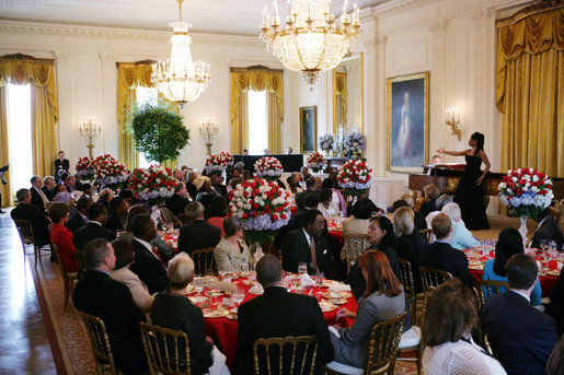 President George W. Bush and Mrs. Laura Bush join invited guests in listening to vocal star Denyce Graves at a White House social luncheon in honor of Liberia's President Ellen Johnson Sirleaf, Tuesday, March 21, 2006, at the White House. White House photo by Shealah Craighead