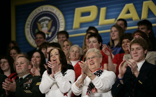 Audience members applaud President George W. Bush as he discusses the global war on terror, Wednesday, March 22, 2006 at the Capitol Music Hall in Wheeling, W. Va. President Bush told the crowd that America has got to appreciate what it means to wear the uniform today, and honor those who have volunteered to keep this country strong. White House photo by Eric Draper