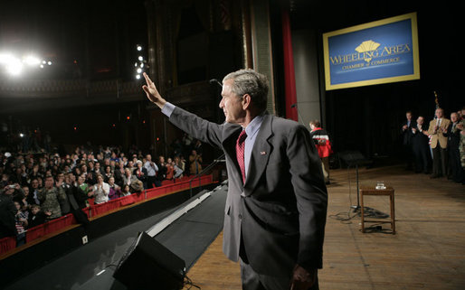 President George W. Bush waves as he leaves the Capitol Music Hall stage following his address on the global war on terror, Wednesday, March 22, 2006 in Wheeling, W. Va. White House photo by Eric Draper