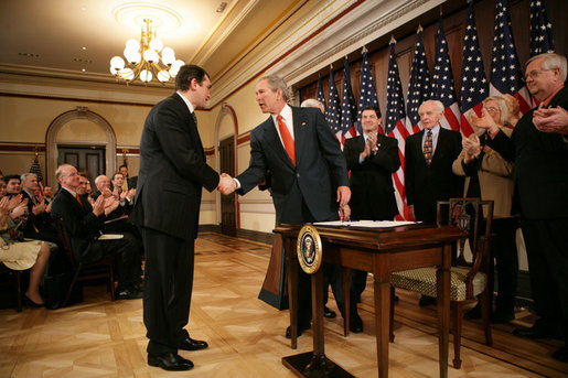 President George W. Bush shakes hands with Ukrainian Ambassador Oleh Shamshur, after President Bush signed H.R. 1053, to authorize the Extension of Nondiscriminatory Treatment to the Products of Ukraine, Thursday, March 23, 2006, in the Eisenhower Executive Office Building in Washington. President Bush was joined at the ceremony by legislators, U.S. Sen. Richard Lugar, R- Ind.; U.S. Rep. Jim Gerlach, R-Pa.; U.S. Rep. Tom Lantos, D-Calif.; U.S. Rep. Candice Miller, R-Mich; U.S. Rep. Curt Weldon, R-Pa., and U.S. Rep. Mike Fitzpatrick, R-Pa. White House photo by Kimberlee Hewitt