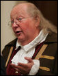 Benjamin Franklin interpreter, Ralph Archbold of Philadelphia, Pa., speaks with guests Thursday evening, March 23, 2006 in the Blue Room of the White House, at a Social Dinner hosted by President George W. Bush and Mrs. Laura Bush to honor the 300th birthday of Benjamin Franklin. White House photo by Paul Morse