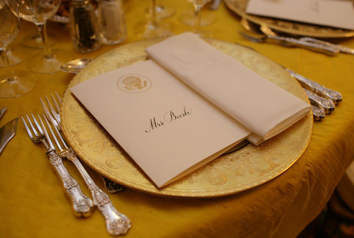 The dinner setting for Mrs. Laura Bush is seen Thursday evening, March 23, 2006 in the Blue Room of the White House, set a Social Dinner hosted by President George W. Bush and Mrs. Bush in honor of the 300th Birthday of Benjamin Franklin White House photo by Shealah Craighead