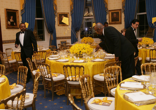 white house butlers place the finishing touches on table settings and decorations thursday evening march 23 2006 in the blue room of the white house blue room white