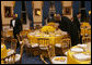White House butlers place the finishing touches on table settings and decorations, Thursday evening, March 23, 2006 in the Blue Room of the White House, for a Social Dinner hosted by President George W. Bush and Mrs. Laura Bush in honor of the 300th Birthday of Benjamin Franklin. White House photo by Shealah Craighead