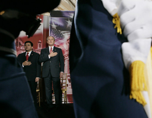 President George W. Bush and U.S. Attorney General Alberto Gonzales are framed by a military honor guard Monday, March 27, 2006, during the Naturalization Ceremony at the Daughters of the American Revolution Administration Building in Washington. President Bush, speaking to those who were swearing-in as new U.S. citizens, said that each generation of immigrants brings a renewal to our national character and adds vitality to our culture. White House photo by Eric Draper