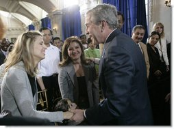President George W. Bush congratulates newly sworn-in U.S. citizens Monday, March 27, 2006, following the Naturalization Ceremony at the Daughters of the American Revolution Administration Building in Washington. President Bush told the new U.S. citizens that each generation of immigrants brings a renewal to our national character and adds vitality to our culture.  White House photo by Eric Draper