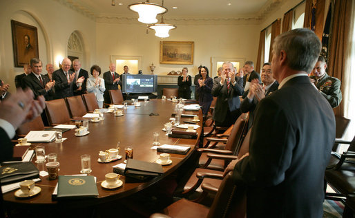 Secretary Andy Card is met by member applause Tuesday, March 28, 2006, as he enters the Cabinet Room moments after President George W. Bush announced the Chief of Staff's resignation. White House photo by David Bohrer