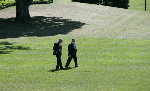 President George W. Bush and Chief of Staff Andrew Card walk alone on the South Lawn in this September 2005 file photo. President Bush announced Tuesday, March 28, 2006, that he had accepted Secretary Card's resignation, effective in April. White House photo by Eric Draper