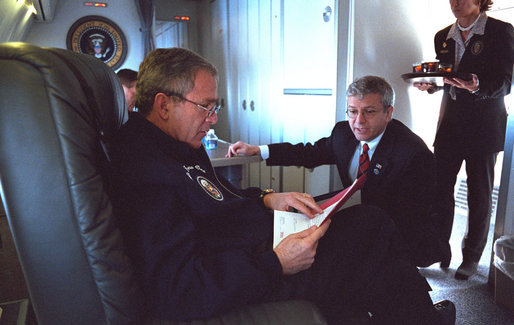 In this January 2002 file photo, President George W. Bush confers with Josh Bolten aboard Air Force One en route to Portland, Maine. President Bush announced Tuesday, March 28, 2006, that Director Bolten, of the Office of Management and Budget, will succeed Secretary Andrew Card as Chief of Staff. White House photo by Eric Draper
